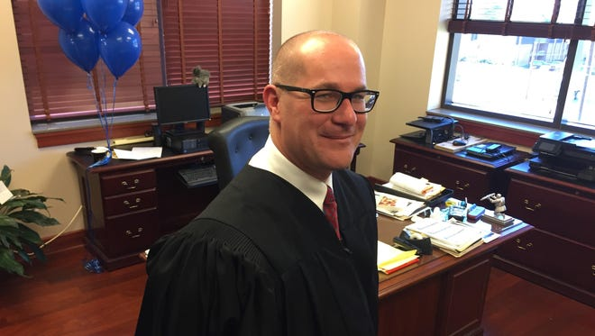 Judge Cameron Blau settles into his Campbell County District Court chambers in the Newport courthouse two days after winning election Nov. 8 to continue serving two more years in judicial robes. Blau was appointed to fill in as judge by Gov. Matt Bevin in June until elections.