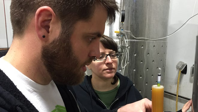 Scott Emond and Jesse Kleinedler test a brew at Under the Rose Brewing Co. The brewery will host the Freeze Your Pints Off beer festival on Saturday.