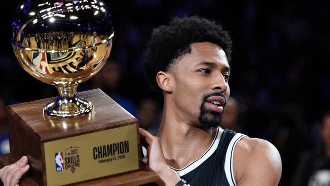 Brooklyn Nets' Spencer Dinwiddie holds up his trophy after winning the NBA All-Star basketball Skills Challenge, Saturday, Feb. 17, 2018, in Los Angeles.