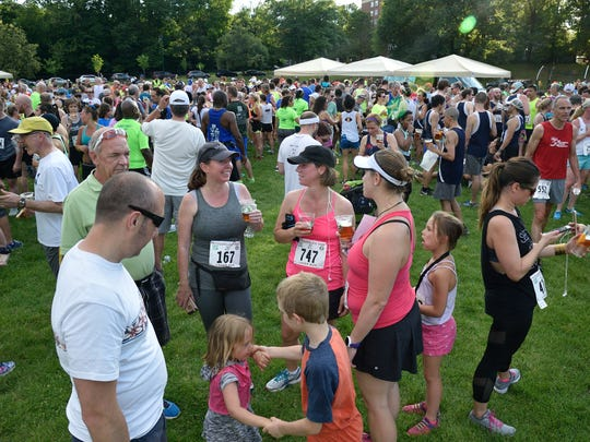 Runners enjoy a cold beer at the end of the Fitzgerald's 1928 Lager 5K Run in Glen Ridge