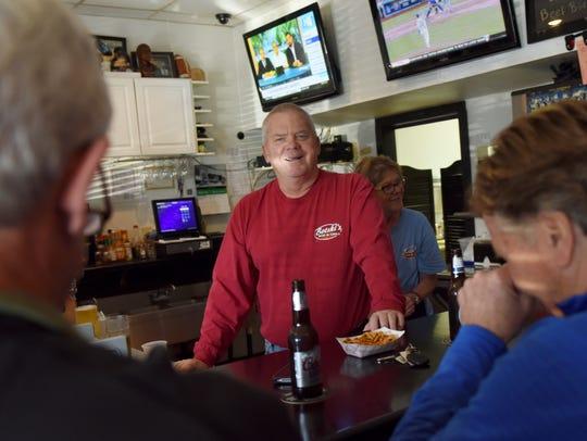Jon Bot (center), owner of Botski's Bar and Grill,