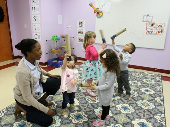Mozarts and Einsteins, a new preschool that just opened at 175 Gatzmer Ave. in Jamesburg is photographed on Thursday June 4 ,2015. Here school director Jessica Linton (left) works with students during their music class.