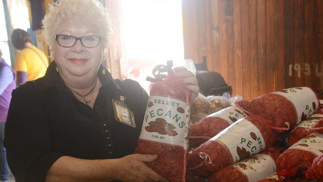 Juli Leavitt in 2014 ran the Country Store in Colfax where visitors to the Louisiana Pecan Festival can purchase pecans.