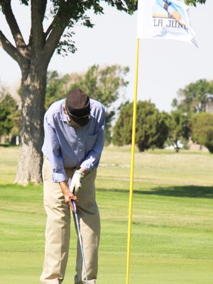 Max Romero taps in a short putt on the ninth green in the first La Junta Seniors Golf League tournament of the season. Romero was on the winning team.