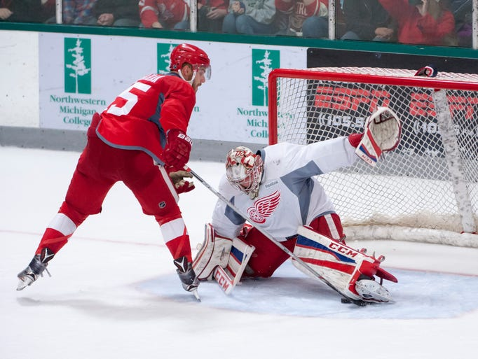 Riley Sheahan can't get the puck past goalie Jake Paterson
