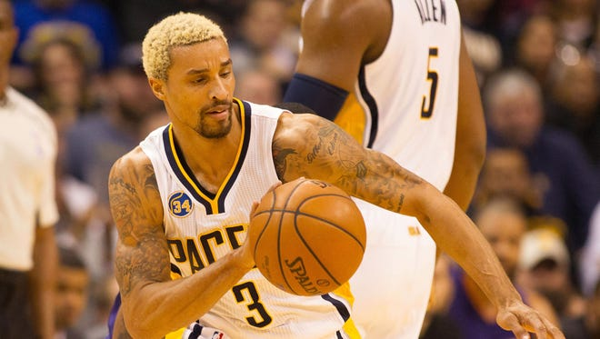 Indiana Pacers guard George Hill (3) dribbles the ball in the first quarter against the Phoenix Suns at Bankers Life Fieldhouse.