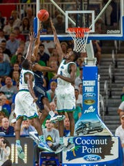 Especially lately, FGCU really misses the athleticism of graduated forwards Marc-Eddy Norelia (left) and Demetris Morant.