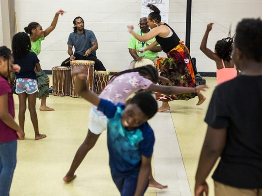 July 18, 2018 - Javis Washington, left, and John Washington, right, play the drums while students dance during the New Ballet Ensemble and School's Summer Dance Explorers Camp. New Ballet Ensemble and School hosted their first annual Summer Dance Explorers Camp that is a two-week long, day camp event that hosts kindergarten through 5th graders.