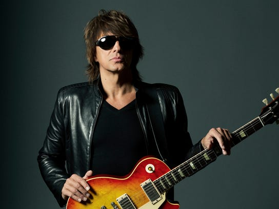 Richie Sambora with a Gibson Les Paul guitar.