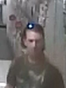 Greenwood police say the man in this surveillance photo took pictures of two boys in a bathroom at the Kohl's store.