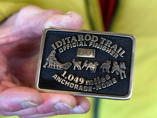 Brett Bruggeman's Iditarod belt buckle he received for finishing the Iditarod sled dog race this year. Bruggeman finished in 39th place in the iconic race. It was his first time competing.
