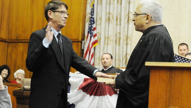 Tony Matula on left takes the oath from Judge Samuel Kline on Jan. 2, 2014.