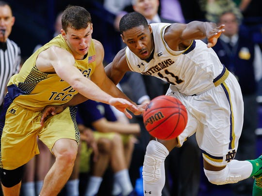 Travis Jorgenson #10 of the Georgia Tech Yellow Jackets and Demetrius Jackson #11 of the Notre Dame Fighting Irish chase a loose ball at Purcell Pavilion on January 3, 2015 in South Bend, Indiana. (Photo by Michael Hickey/Getty Images)