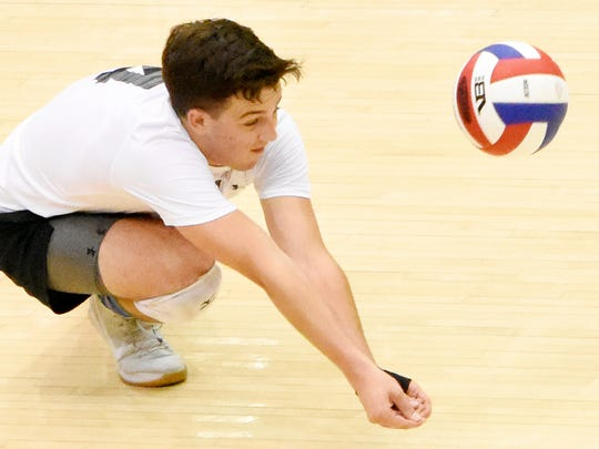 Central York's Zak Kakos gets in a dig during the PIAA