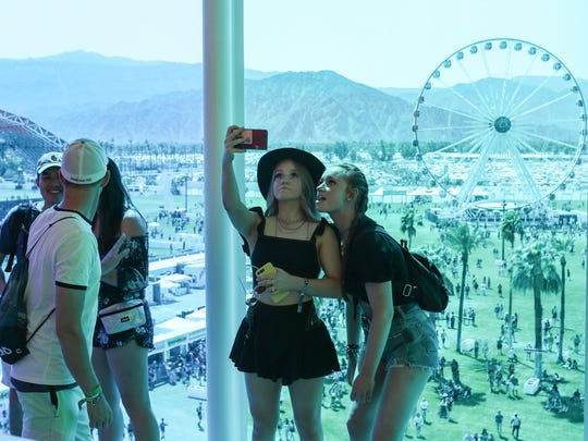 Apr 13, 2018; Indio, CA, USA; Music fans take pictures inside the Spectra art installation during the Coachella Valley Music and Arts Festival at Empire Polo Club. Mandatory Credit: Jay Calderon/The Desert Sun via USA TODAY NETWORK