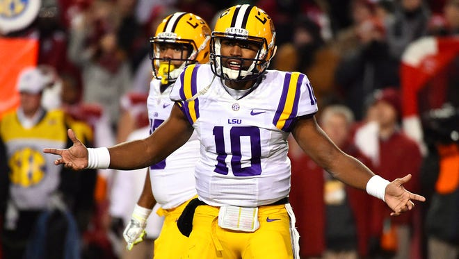 LSU Tigers quarterback Anthony Jennings (10) signals to the sidelines in the game between the Arkansas Razorbacks and the LSU Tigers during the first half at Donald W. Reynolds Razorback Stadium.