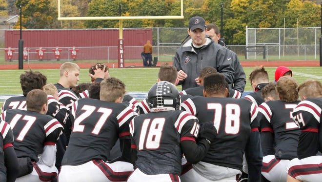Elmira head coach Jimmy McCauley talks to his team after a win over Vestal on Oct. 22 at Ernie Davis Academy.