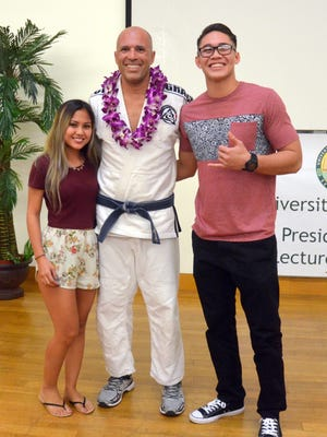 """Over 200 people packed the University of Guam's College of Liberal Arts & Social Sciences Lecture Hall on Tuesday, Nov. 17 to watch UFC Hall of Famer Royce Gracie speak on """"The History and Philosophy of Gracie Jiu-Jitsu."""" After Gracie's lecture, he stayed back to allow for personal photos with him and admiring fans."""