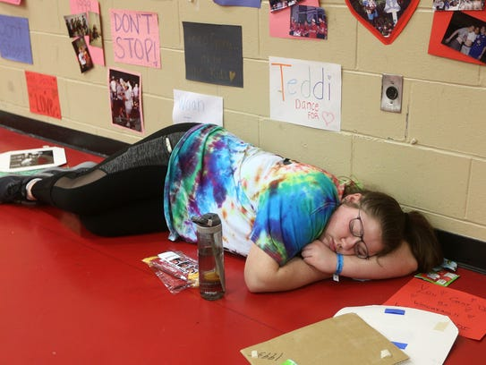 St. John Fisher student Ally Wichtowski catches a few minutes of sleep during the second day of the Teddi Dance for Love.