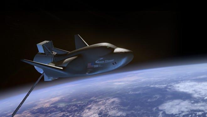 Artist rendering of Sierra Nevada Corp.'s Dream Chaser cargo vehicle in orbit.