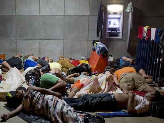 Cuban migrants sleep outside the border control building