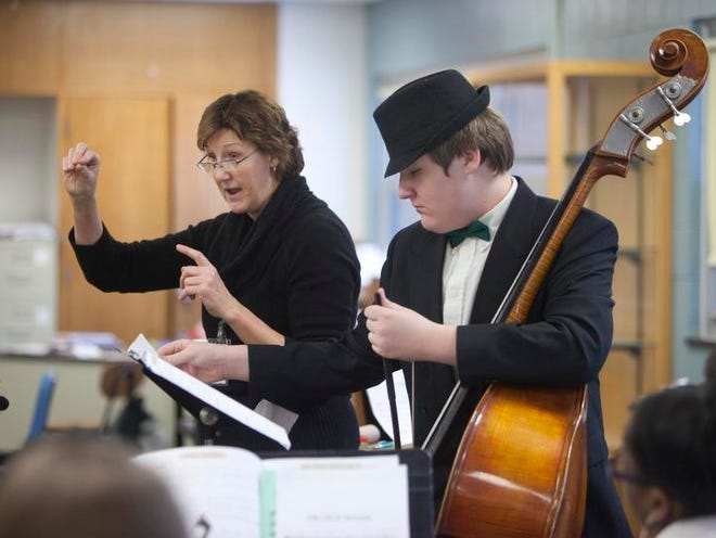 Orchestra director Susan Sieler (left) and bassist Darwin Buster prepare for a performance at Harshman.