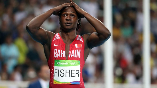 Andrew Fisher (BRN) reacts after a false start during the men's 100m semifinals in the Rio 2016 Summer Olympic Games at Estadio Olimpico Joao Havelange.