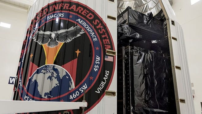 The Air Force's third Space Based Infrared System satellite was encapsulated in a payload fairing in preparation for a Jan. 19 launch from Cape Canaveral on a United Launch Alliance Atlas V rocket.