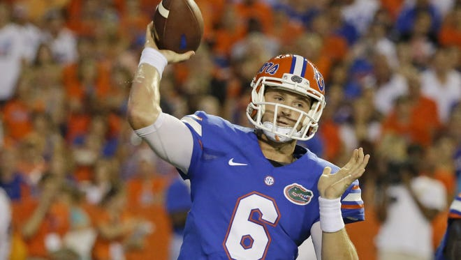 Florida quarterback Jeff Driskel said Kentucky confounded the UF offense with defensive looks the Gators had not seen on film.