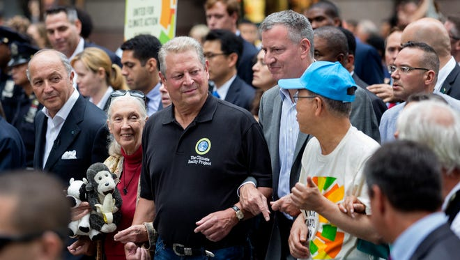 From left, French Foreign Minister Laurent Fabius, primatologist Jane Goodall, former Vice President Al Gore, New York Mayor Bill de Blasio and UN Secretary General Ban Ki-moon participate in the climate march.