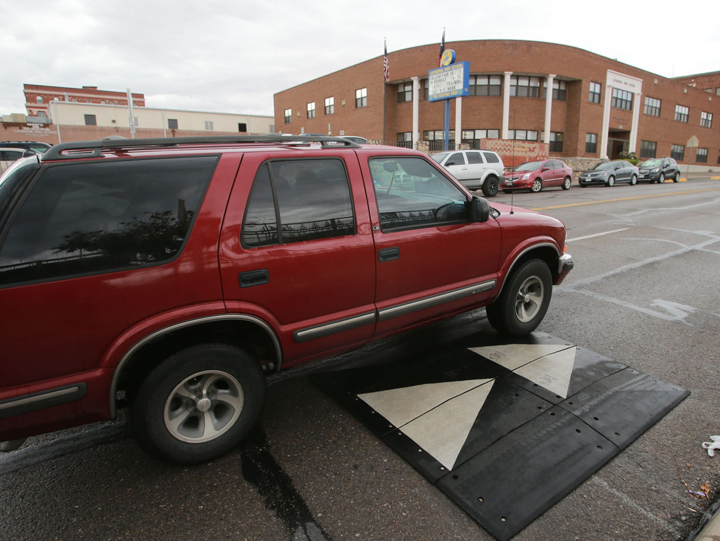 A vehicle negotiates a speed hump on North Stanton