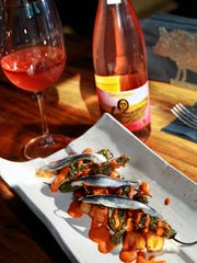 Fried shishito peppers and potatoes with romesco and