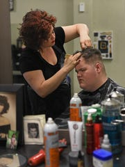 Leisa McCormick cuts Judah Stampley's hair at her Shreveport hair salon.