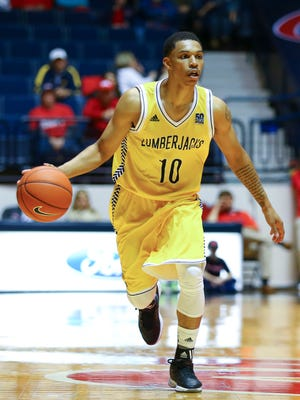 Northern Arizona Lumberjacks guard Jaleni Neely (10) brings the ball up court during the game against the Mississippi Rebels at C.M. Tad Smith Coliseum in Oxford, Miss., on Nov. 23, 2015.