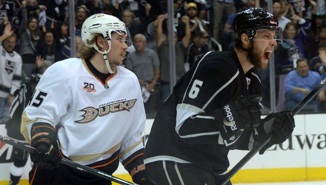 Los Angeles Kings defenseman Jake Muzzin (6) celebrates after scoring a goal in the first period.