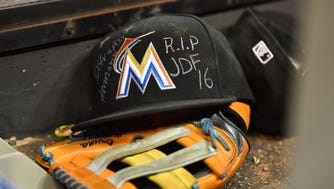 Marcell Ozuna wore a tribute to Jose Fernandez on his hat.