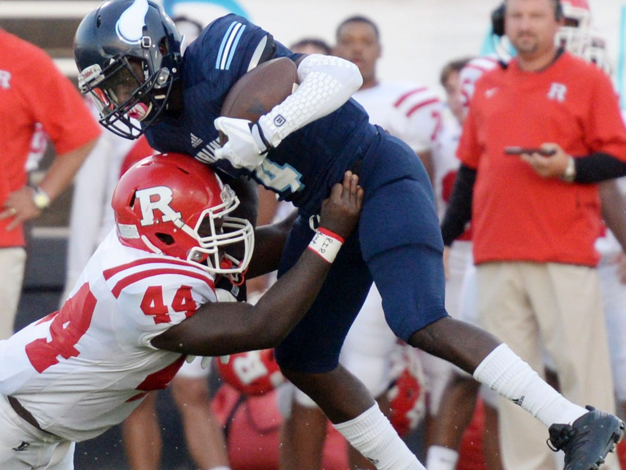 Ruston's Courtney Mamon tries to stop Airline's Coby Mcgee during their game Friday evening at Airline High School.