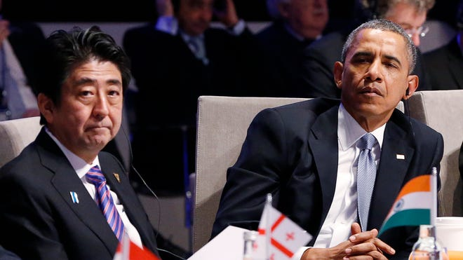Japan's Prime Minister Shinzo Abe, left, and President Obama attend the opening session of the Nuclear Summit in The Hague, Netherlands, on Monday.