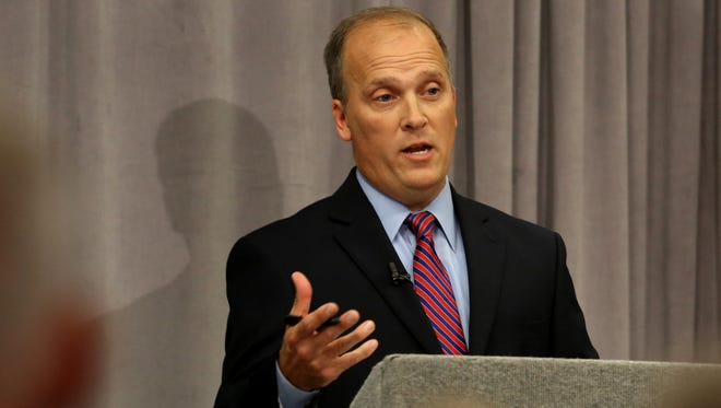 Wisconsin Attorney General candidate Brad Schimel speaks during a debate with opponent Susan Happ at the Wisconsin State Bar Center in Madison on Wednesday.