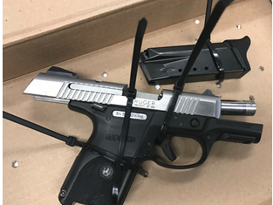 Oxnard police reported finding this loaded handgun in the stolen car of a known gang member during an arrest early Sunday.