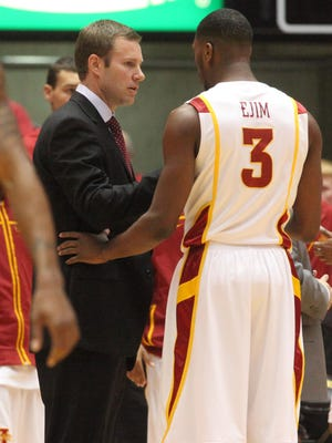 ISU Head Coach Fred Hoiberg talks with player (3) Melvin Ejim during a time out. des.s0112isu.missouri.mbb - ISU vs. Missouri Men's hoops  - 01-11-2012 - Iowa State men's basketball vs. Missouri at Hilton Coliseum. Ames, Iowa. ISU lost 69-76.  (Andrea Melendez/The Register)