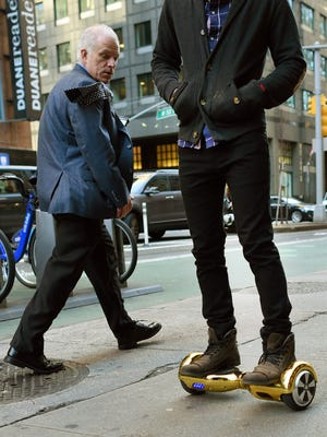 Whizboard Store manager 'Mor Loud'  demonstrates the Hoverboard on Broadway in Times Square in New York on Dec. 15, 2015.