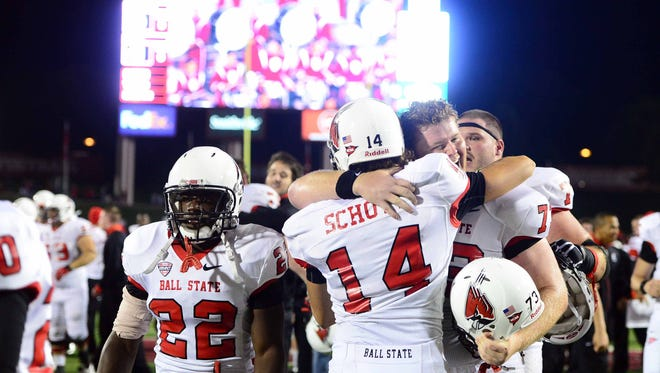 Sep 15, 2012; Bloomington, IN, USA; Ball State Cardinals kicker Steven Schott (14) celebrates with teammates after kicking the game winning field goal to defeat Indiana Hoosiers 41-39 at Memorial Stadium.