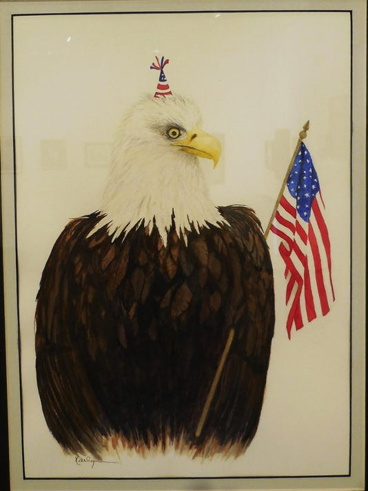 Mesquite Fine Arts Gallery-Let's Party says Karlynn Jones' bald eagle as he wave