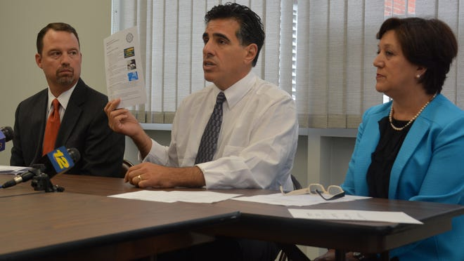 Officials met Sept. 29 at the Middlesex County Superintendent's Office in North Brunswick to discuss ways that residents can help protect their families from Enterovirus D68, a viral respiratory infection found in children. The county is working with the superintendent to disseminate a fact sheet about the virus to all Middlesex County schools. Pictured from left to right are Dr. Chistopher Haines, chief medical officer at Children's Specialized Hospital at Robert Wood Johnson University Hospital in New Brunswick; Freeholder H. James Polos, chair of the county's Public Safety and Health Committee, and Laura Morana, interim executive county superintendent.
