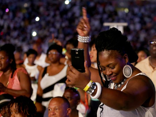 A concert goer dances as she listens to Maze featuring Frankie Beverly perform during Cincinnati Music Festival presented by P & G Saturday July 25, 2015 at Paul Brown Stadium.