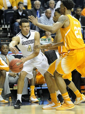 Vanderbilt guard Wade Baldwin IV (4) passes the ball around Tennessee forward Derek Reese (23) in the SEC Basketball Tournament on March 12, 2015 at Bridgestone Arena.