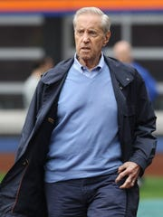 Mets owner Fred Wilpon on the field watching the workout.