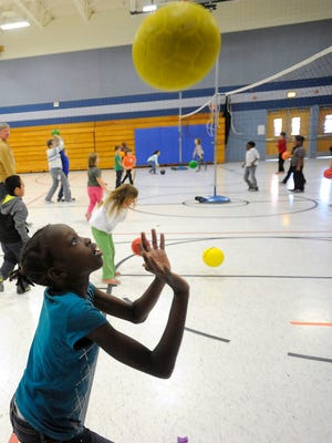 Acel Aguer plays volley during gym class at Anne Sullivan Elementary School in Sioux Falls, S.D., Thursday, Nov. 20, 2014.