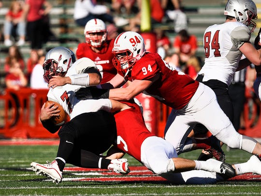 St. John's defensive end Ted Kalina, 94, and linebacker Parker Anderson sack Hamline quarterback Justice Spriggs for a loss during the first half Saturday, Nov. 5, at Clemens Stadium.